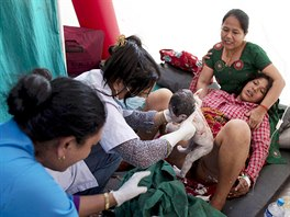 Maya Tamang, 20, gives birth to her daughter after an earthquake at...