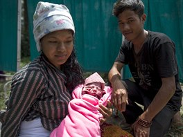 Maya Tamang (L), 20, and Buddha Tamang (R), 21, sit with their one-day-old...
