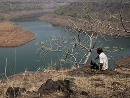 A villager sits on a hill overlooking part of Bhatsa dam on the outskirts of...