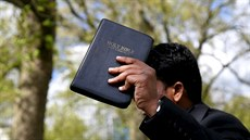 A Christian speaker holds a copy of the Bible at Speakers' Corner in Hyde...