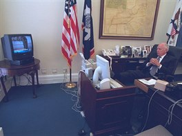 U.S. Vice President Dick Cheney watches television reports in Washington in the...