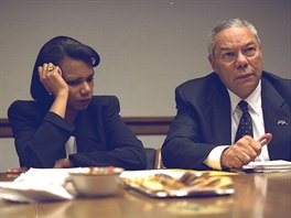 U.S. Secretary of State Colin Powell (R) and National Security Advisor...