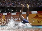 Rolanda Bell of Panama falling head first into the water obstacle during the...