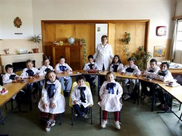 Teacher Ana Dorrego poses with students of the rural school Agustin Ferreira on...