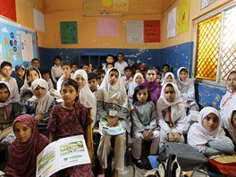 Third grade students attend class at the Mashal Model School on the outskirts...