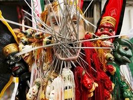A devotee of the Chinese Bang Neow shrine with spikes pierced at his cheeks...