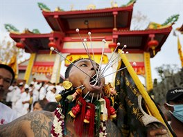 A devotee of the Chinese Jui Tui shrine walk with spikes pierced on his cheeks...