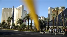 News crews stand in front of the closed Las Vegas Strip next to the site of the...