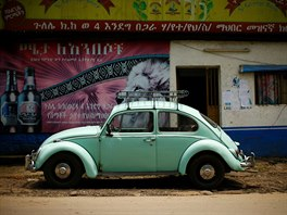 A Volkswagen Beetle car is parked in front of a grocery store in Addis Ababa,...