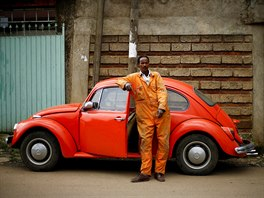 Ishetu Kinfe, 59, a mechanic, poses next to his 1965 model Volkswagen Beetle...