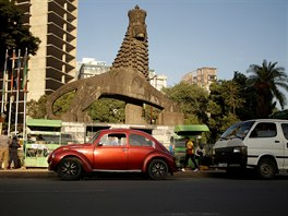 A 1978 model Volkswagen Beetle is parked near the Ethiopian National Theatre...