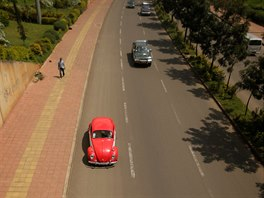 A Volkswagen Beetle car travels along a road in Addis Ababa,...