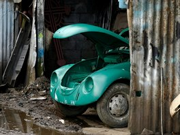 A Volkswagen Beetle car is seen inside a painting room at a garage in Addis...