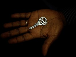 The owner of a 1970 model Volkswagen Beetle car holds the key to his car, in...