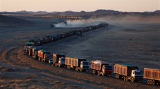 Thousands of heavy-duty trucks loaded with coal are lined up for up to 130...