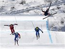 Christopher Del Bosco of Canada, right, flies through the air before crashing...
