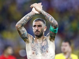 Serbia's Aleksandar Kolarov applauds fans at the end of the group E match...