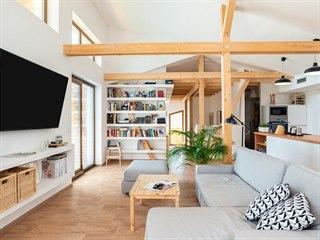 Srdcem domu je kuchyně jako součást hlavního obytného prostoru spolu s obývákem...
