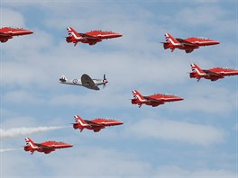 The Red Arrows, Royal Air Force Aerobatic Team, are joined by a Spitfire at the...