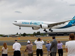 Spectators look at an Airbus A330-900 at the Farnborough Airshow, in Farnborough