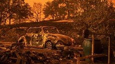 A Volkswagen Beetle scorched by a wildfire called the Carr Fire rests at a...