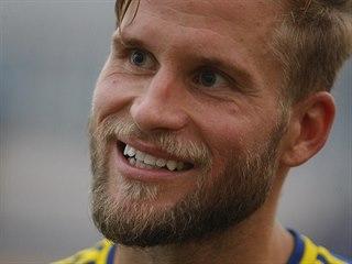 Petr Tlustý z Jihlavy se usmívá po vyhraném utkání s Táborskem.