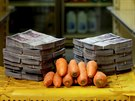 A kilogram of carrots is pictured next to 3,000,000 bolivars, its price and...