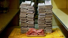 A kilogram of meat is pictured next to 9,500,000 bolivars, its price and the...