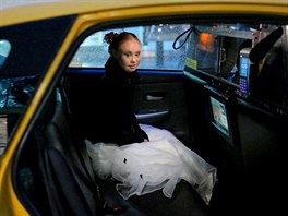 Model Madeline Stuart sits in the back of a taxi cab after walking in a runway...