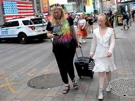 Model Madeline Stuart (R) walks through Times Square with her mother and...