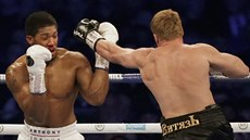 British boxer Anthony Joshua, left, his nose bleeding, fights Russian boxer...