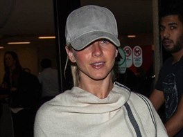 Julianne Hough keeps a low profile in poncho with Brooks Laich at LAX airport...