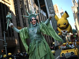 Content: Performers and balloons move through Sixth Avenue during the...