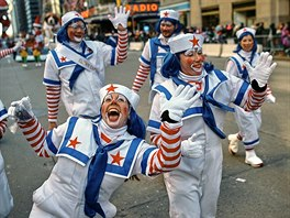 Clowns wave to the crowd along Sixth Avenue during the Macy's Thanksgiving Day...