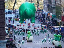 A Dinosaur ballon is carried down 6th Avenue during the 92nd...