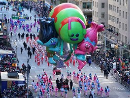 A Trolls ballon is carried down 6th Avenue during the 92nd Macy's Thanksgiving...