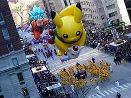 A Pikachu ballon is carried down 6th Avenue during the 92nd...