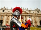 A Swiss guard is seen before the Easter Mass at St. Peter's Square at the...