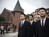 Huawei security guards line-up at the end of their workday at the new...