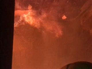Z hořícího domu v Teplicích hasiči zachránili 14 lidí a kočku