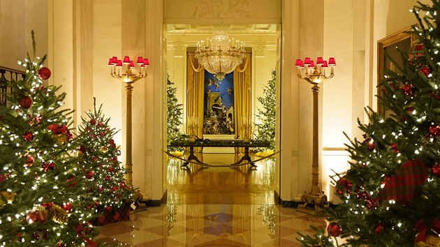 The Cross Hall leading to the East Room of the White House is decorated during the 2020 Christmas preview, Monday, Nov. 30, 2020, in Washington. (AP Photo/Patrick Semansky)
