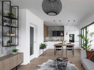 V obývací části pokoje dominuje televizní stěna s atypickou komodou na nožkách...
