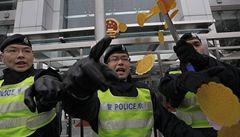 Čínský soud poslal za mříže aktivisty. Bojovali proti korupci
