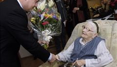 Mgr Dalibor Mlejnský, the Prague 11 mayor, congratulates his district's oldest resident, Marie Helclová, on her 105th birthday