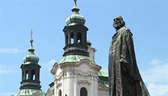 Church restitution battle rooted in prejudices dating back hundreds of years, Czech culture minister says. Statue of reformer Jan Hus pictured in front of a Baroque church, often a symbol of the Catholic counterrevolution