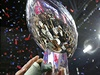 Members of the New England Patriots hold up the Vince Lombardi Trophy after...