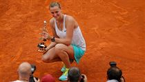 Petra Kvitova of the Czech Republic poses with her trophy after winning the women's final of the Madrid Open Tennis tournament in Madrid, Spain, Satur ...