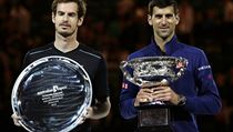 Novak Djokovic, right, of Serbia holds his trophy after defeating Andy Murray, left, of Britain in the men's singles final at the Australian Open tenn ...