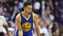 Golden State Warriors guard Stephen Curry reacts after a 3-point basket during the first half of the Warriors' NBA basketball game against the Washing ...