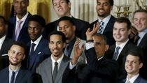 U.S. President Barack Obama simulates taking a shot as Golden State Warriors' Stephen Curry and his teammates look on during an event honoring the 2015 NBA basketball champions at the White House in Washington